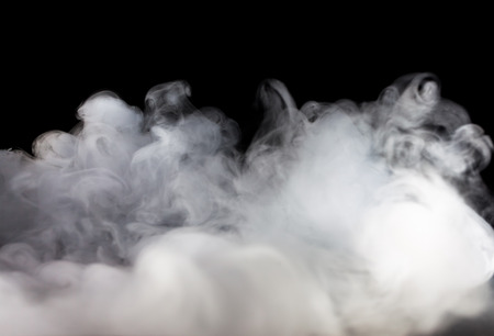 Abstract  fog or smoke move on black color background Imagens