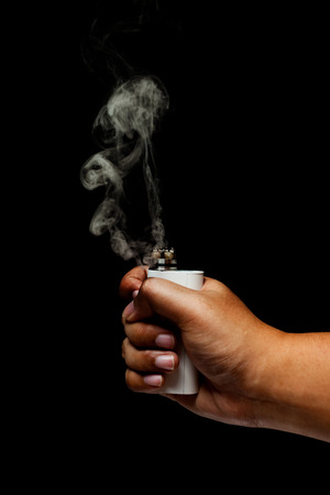 activating: Human Hand activating Electronic Cigarette,vape Over Black Background