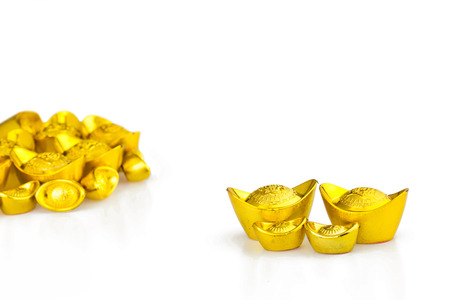 ingots: Gold Chinese ingot (Yuan Bao) on red background with copy space - best for Chinese New Year use