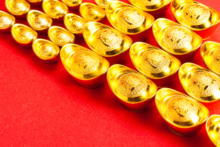 fortunate: Chinese Gold ingot (Sycees, YuanBao ) are used a symbol of prosperity among Chinese people. representing a fortunate year to come. On red color background