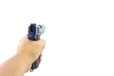Hand holding a handgun. Isolated first person view hand holding a handgun on white background.