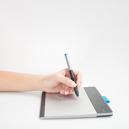 wacom: graphic designer hands writing on digital tablet with copy space for graphic design or website