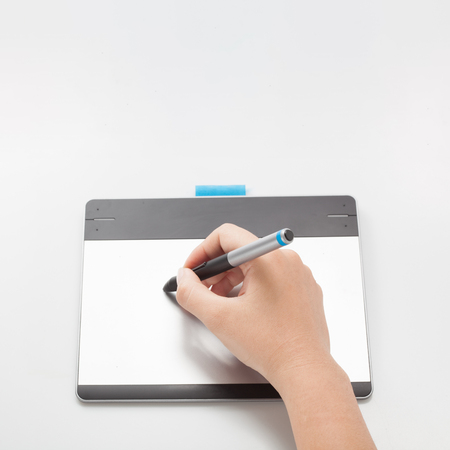 wacom: graphic designer or retoucher hands writing on digital tablet with copy space for graphic design or website