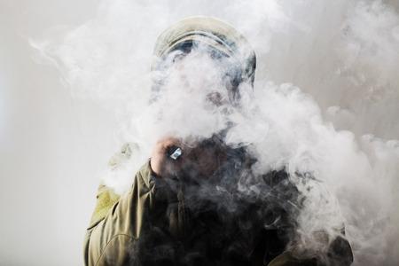 unrecognizable person: Unrecognizable person, Unrecognizable person wearing hood, using electronic cigarette