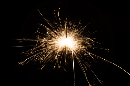 sparklet: A spark over black background for Christmas and new year party Stock Photo