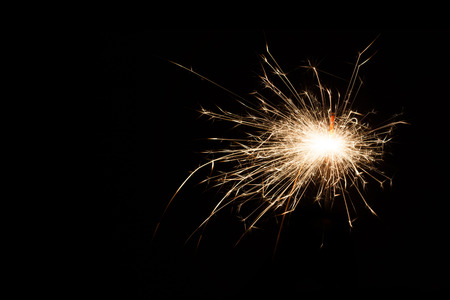 Firework Sparkler on black background, close-up. with copy space Stock Photo
