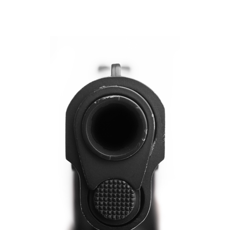 pistol pointing at a camera. Isolated on white background. Zdjęcie Seryjne
