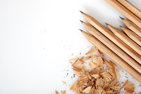 Pencil shavings on white background with copy space. selective focus. Stock Photo
