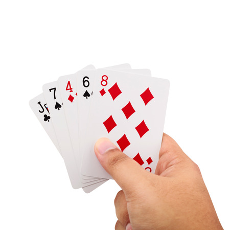 Close up of man hand holding a poker cards isolated on white background
