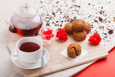 Chinese mid autumn festival foods. Traditional Chinese moon cakes on table setting with teacup. & Chinese Mid Autumn Festival Foods. Traditional Chinese Moon Cakes ...
