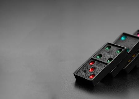 Black domino effect on dark background