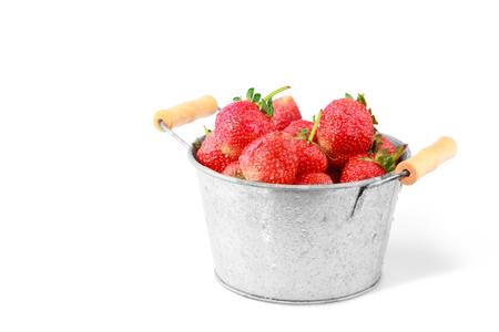 fresh red strawberry in iron bucket on isolated white background 版權商用圖片