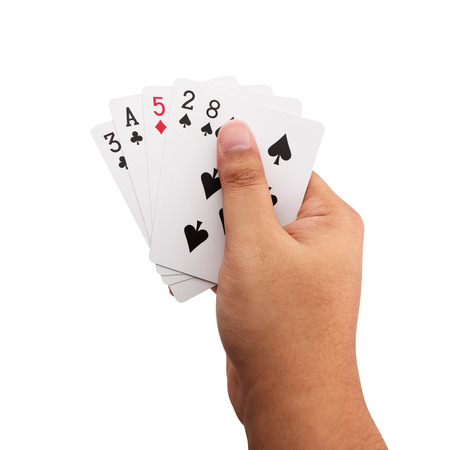 hand holding poker cards isolated on white background with clipping path
