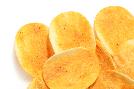 close up of hot and spicy flavor crispy potato chips on isolated white background and clipping path