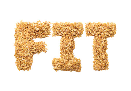 Fit written with oat grains word. Shape of oatmeal flakes on isolated white background