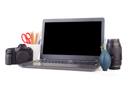 Work place with laptop and camera equipment. Objects on the isolated white background with clipping path and copy space.
