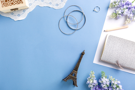 Flat lay of woman accessories on blue background