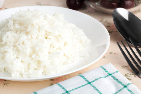 Cooked plain white jasmine rice  serve in  a dish. Close up on the table. Horizontal Фото со стока