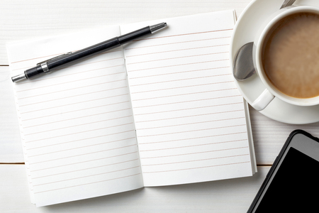 Opened personal organizer with a to do list. on white wooden background. Top view