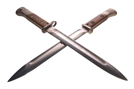 Two old bayonets crossed on white background photo