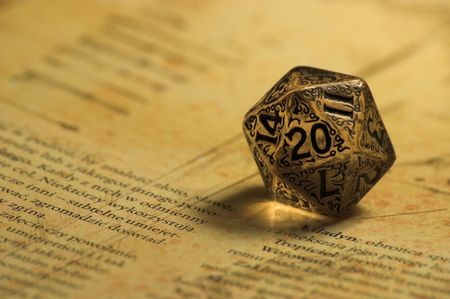 Embellished K20 dice laying on role playing game book Stock Photo