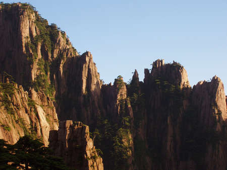 The rock of Huangshan in the setting sun in China Stock Photo