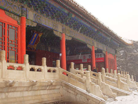 The ancient architecture is in the snow from China