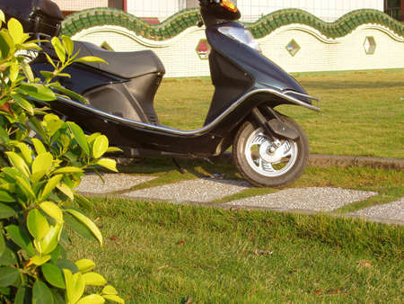 this is a autobike in the road side the park of city.