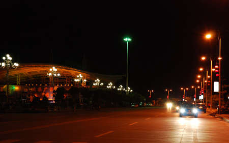 The scenery of street in side sea  in the night.