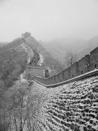 Great wall of China in the snow in the Jurongguan side Beijing photo