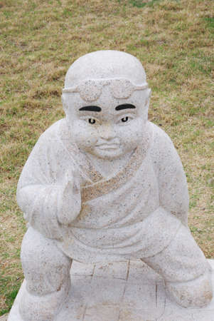 ch: This is a statuary of stone in the park in China