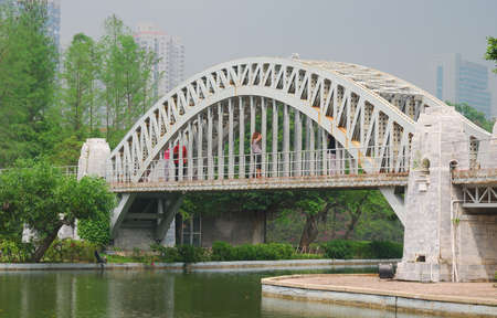 a bridge in a parkl in the south of China