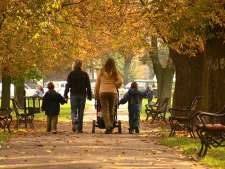 walking paths: A family on a walk in the park Stock Photo
