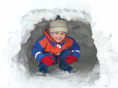 igloo: Little girl playing in the snow