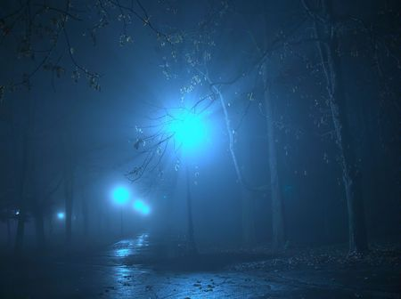 Streetlamp in the fog at night photo