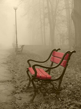 Red bench in the fog Stock Photo