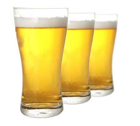 glases: Three glases of beer against white background Stock Photo