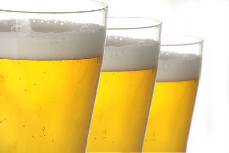 bleb: Three glasses of beer in closeup