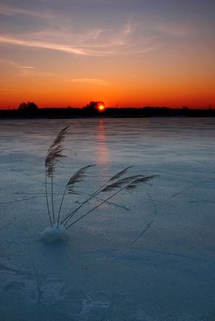 Winter sunset on a frozen lake
