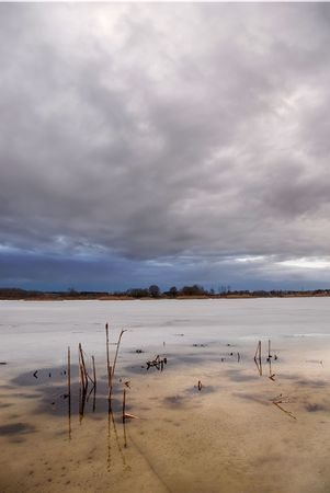 Stormy clouds over a frozen lake Stock Photo - 789679