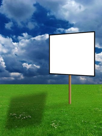 A blank billboard with beautiful summer landscape in the background photo