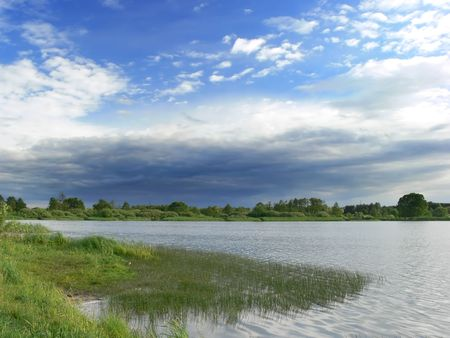 Cloudy sky over a lake in summer photo