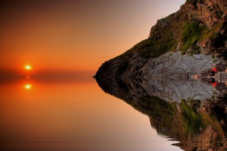 Sunset reflecting in water photo