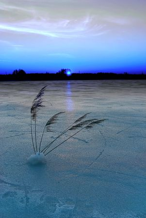 Frozen lake at dusk photo