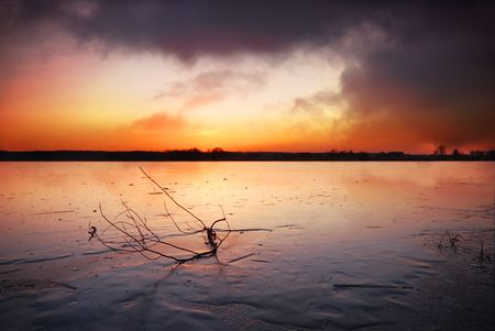 Frozen lake at sunset Stock Photo - 2500954
