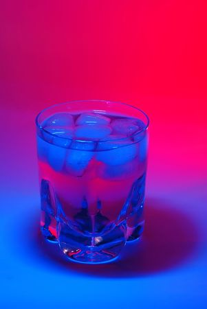 A cocktail in colorful light photo