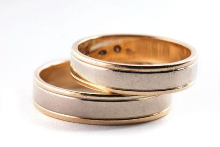 tokens: Wedding rings on white background Stock Photo