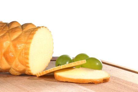 oscypek: Traditional Polish cheese known as oscypek on a wooden board