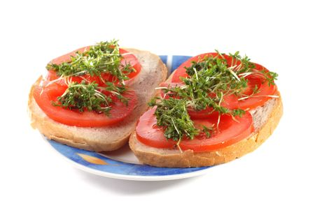 smock: Tomato and cress sandwiches isolated on white background