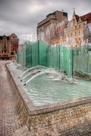 Fountain in the Square in Wroclaw, Poland photo